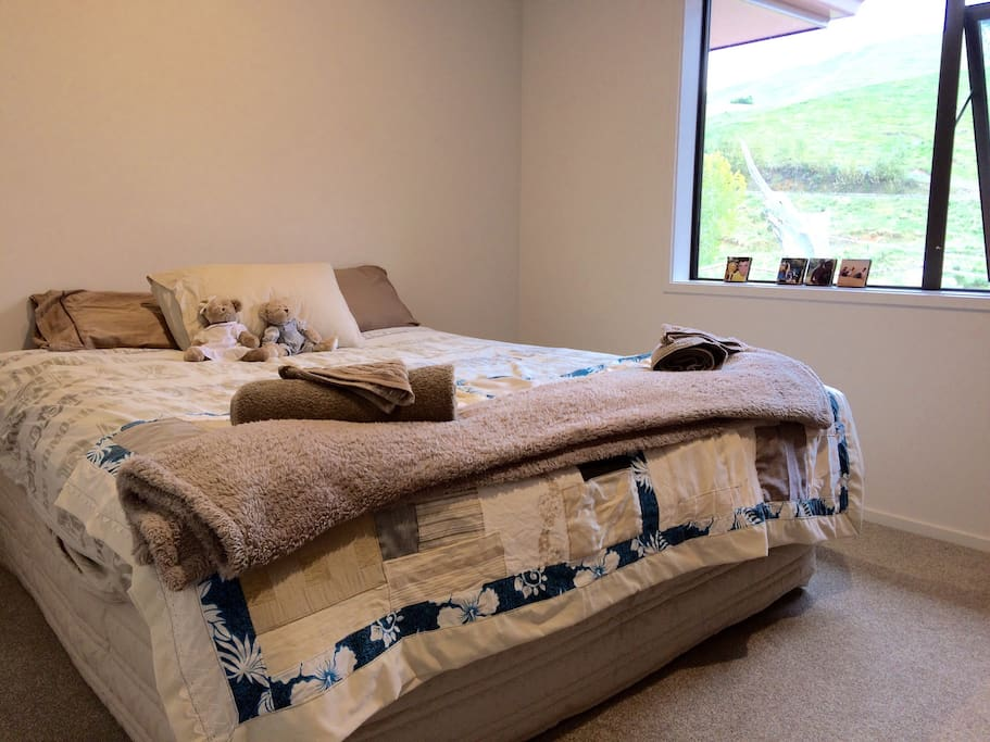 1 of the two guest bedrooms this has a King Size Bed