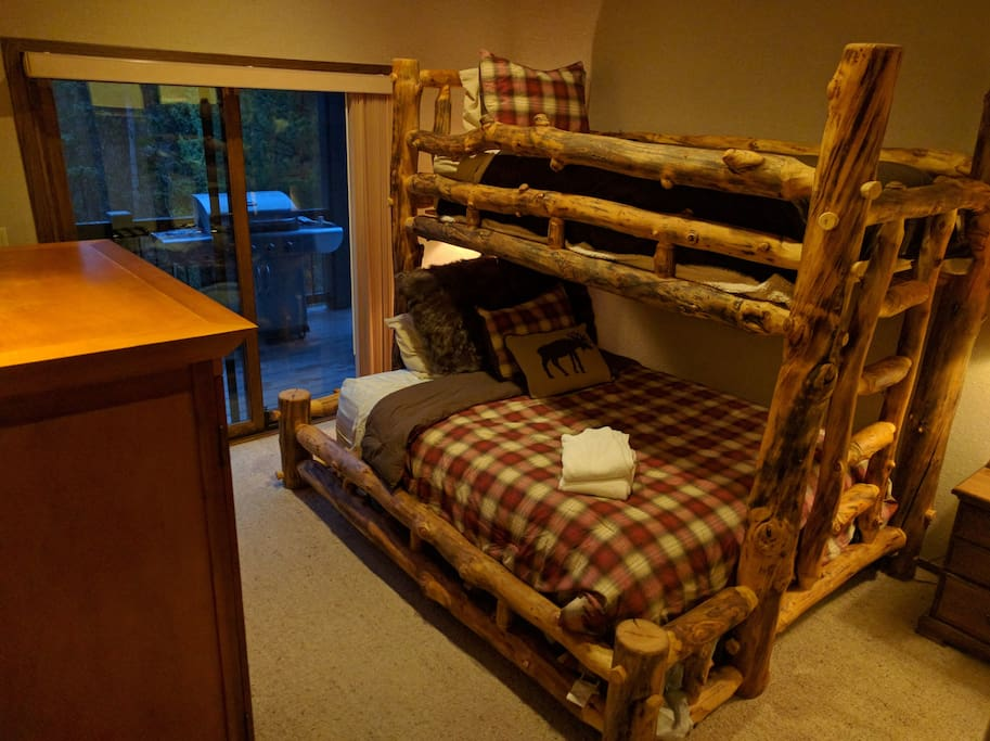 Queens Bunk Room with access to the deck.