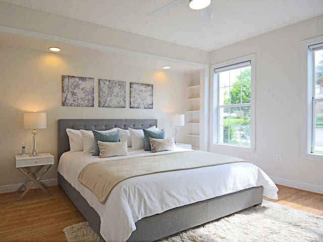 The large 2nd master bedroom has a king-size bed with the highest quality linens
