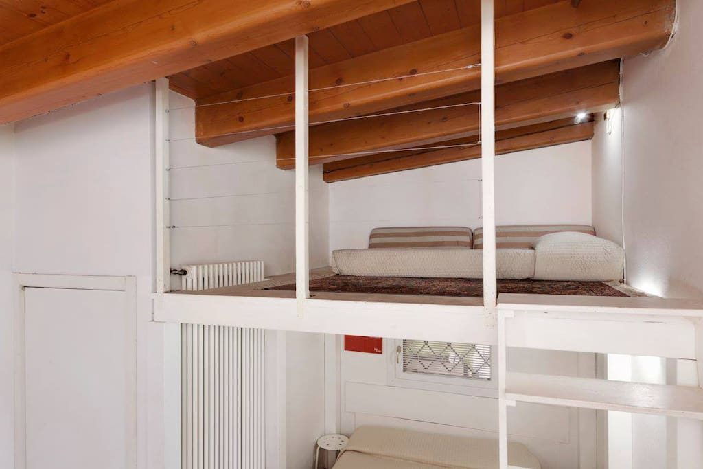 Bed on a mezzanine