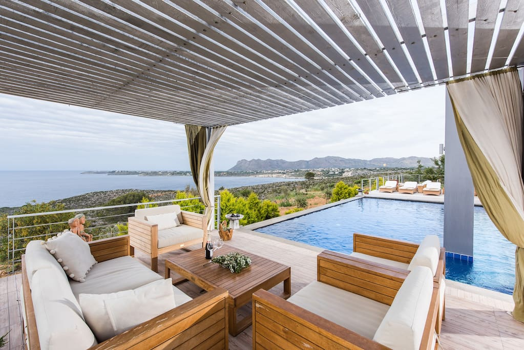Patio by the pool with sea and mountain view