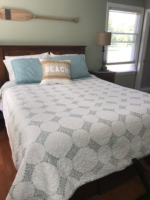 Clean comfortable bed with fresh linens