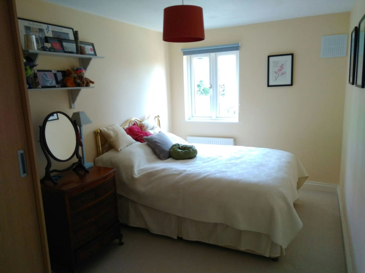 Super-comfortable double bed in a really bright, spacious (110sqft) bedroom!