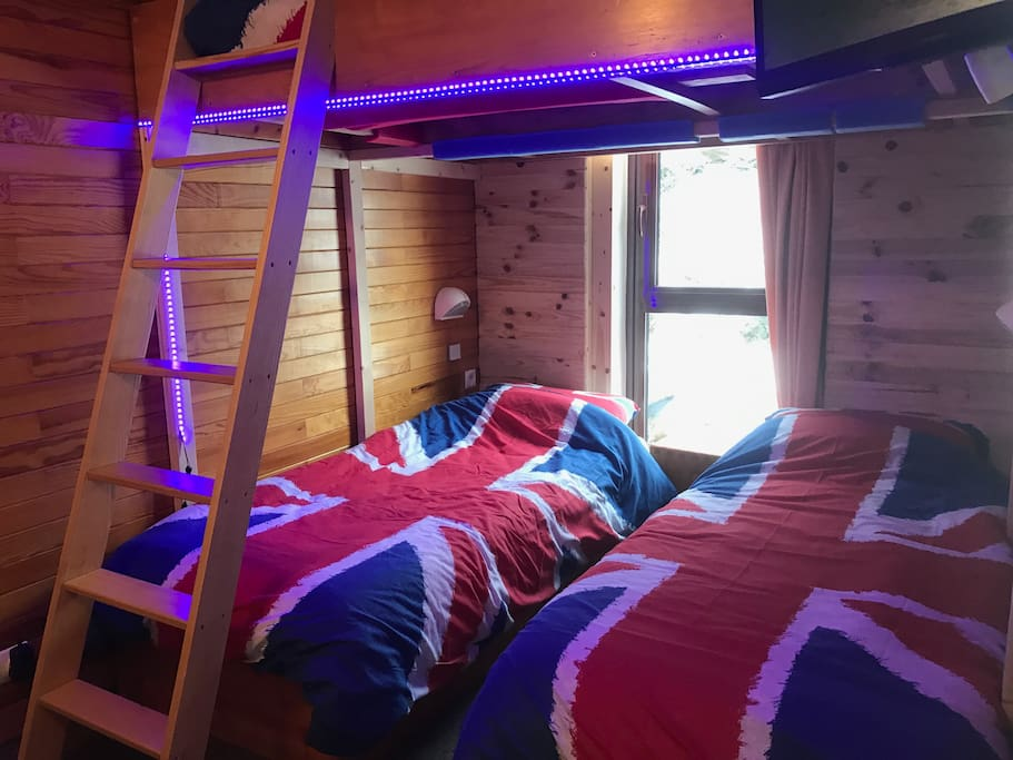 Fixed elevated large double bed above either 2 single or a double bed below.