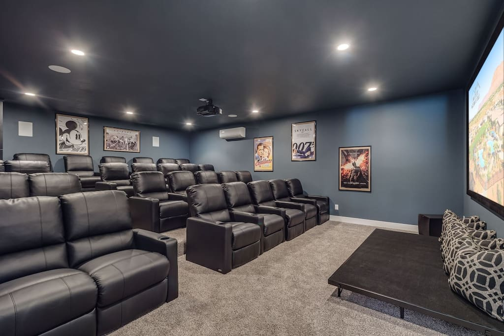 Large customized theater room with 4-tier recliner seating for 28