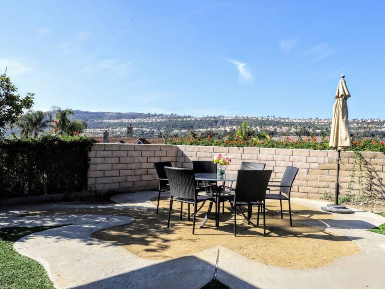 Enjoy this gorgeous view and this outdoor sitting area in the private backyard