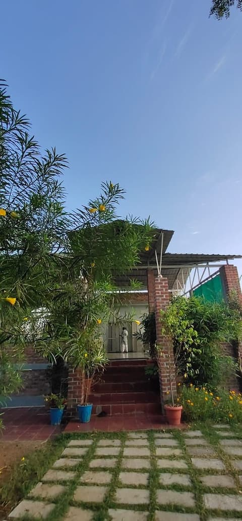 A Blissful place of 3 bedroom in far country side, A perfect getaway from you typical city buzz. A community stay and with lots of warm surprises