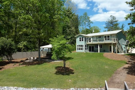 Great lake view on level lot with outdoor kitchen.