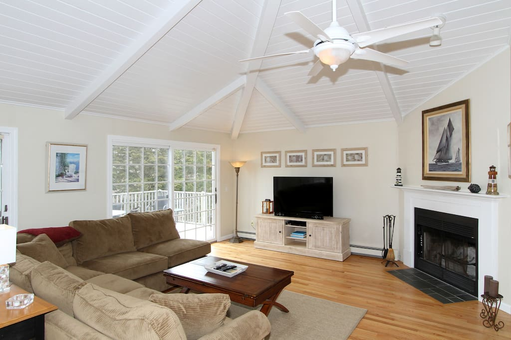 """Six can gather around the fireplace and 55"""" flat-screen TV in the living area."""