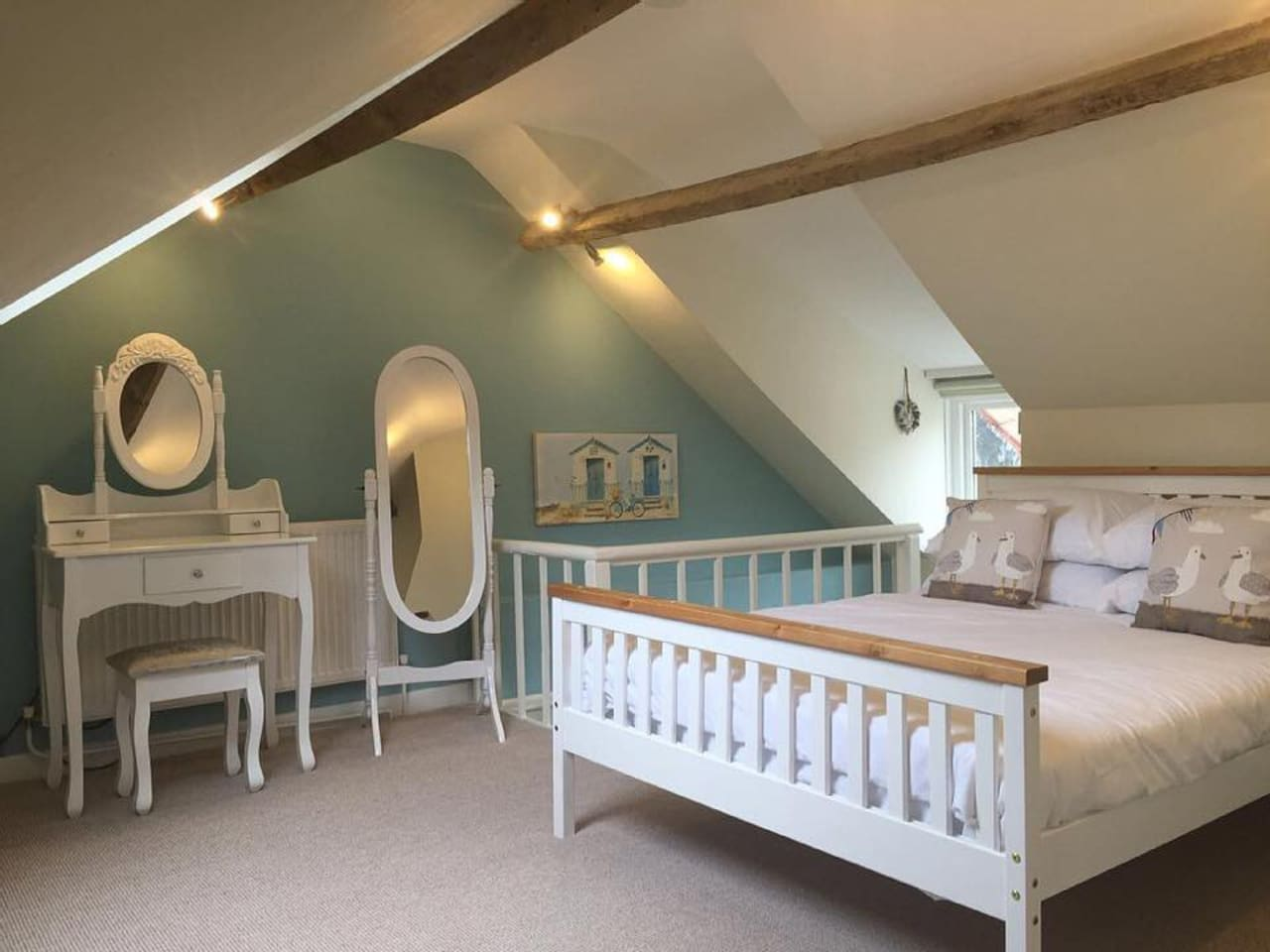 2nd Floor Double Bedroom, with flat screen tv, bespoke fitted draws and luggage spaces. Features views of Scarborough Castle walls.