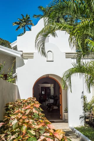 Main Entry Front Door to Villa, take a stroll through the gardens and down to the beach.