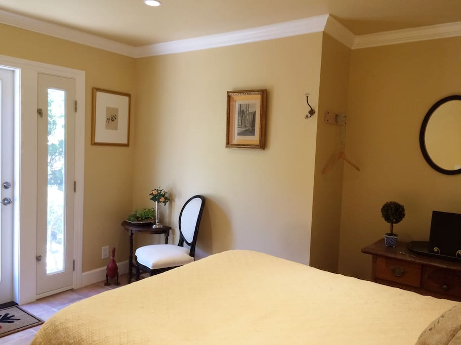 Clean bright recently remodeled bedroom with private garden entrance.