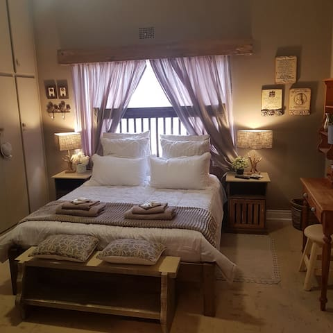Main room with double bed and bunker bed.. ensuite bathroom with bathtub and shower