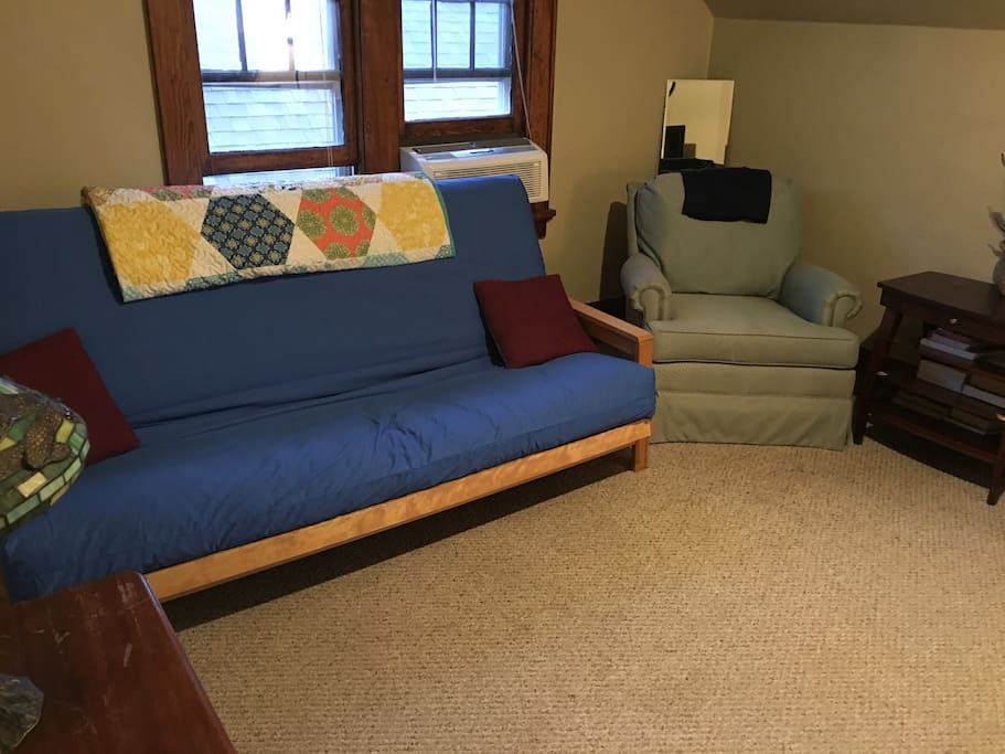 Living room has a nice full size futon and a comfortable reading chair (I recently updated the futon cover).