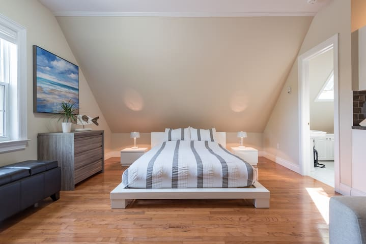 Queen-sized mattress topped with luxurious linens