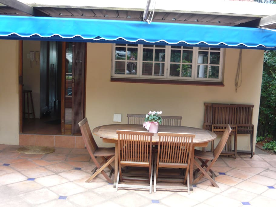 Patio with outdoor dining area and braai/barbeque