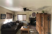 Living room with queen sofa sleeper (memory foam mattress), smart tv, satellite, Bose wireless speaker and blue ray player