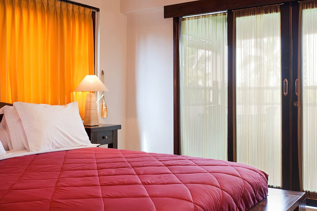 Entrance floor of your 2 story deluxe villa.. with private balcony, day bed table and chairs