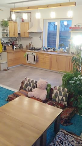 big Hall-Studio with kitchen, tables, TV and soft resting zone