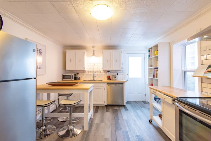 Recently redone kitchen with bright sunshine and access to the back deck.