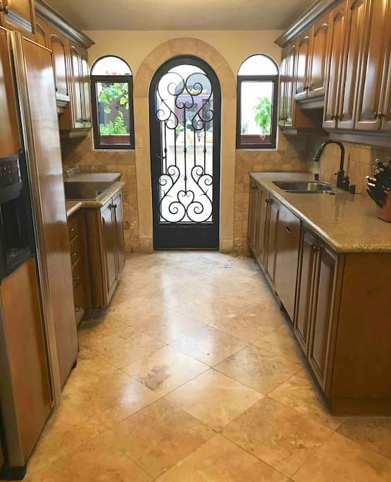 This kitchen is fully equipped with modern appliances and granite counter tops. Off the kitchen patio is the laundry room with a full washer/dryer. Please help yourself to the fresh potted herbs on the patio.