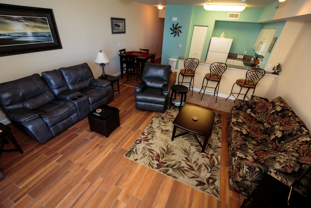 Rocker/recliner love seat with cupholders