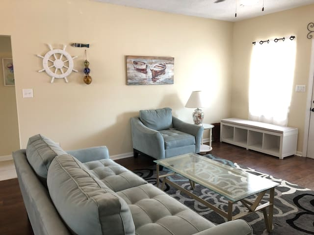 Living Room: with Queen Sleeper Sofa. Beach towels will be stored in basket inside the bench. There will also be empty baskets for you to store shoes.