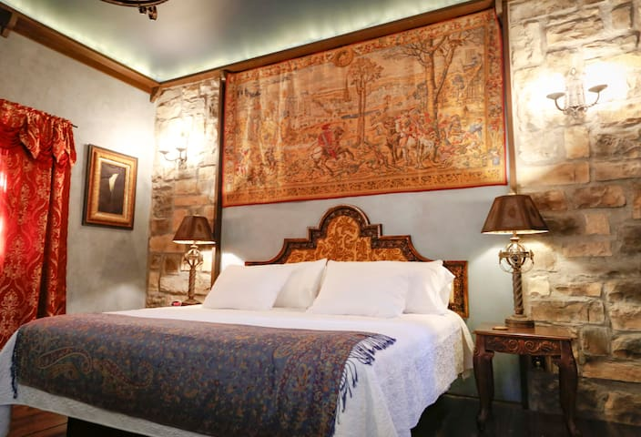 Sleep under a huge classic tapestry like a castle in Europe