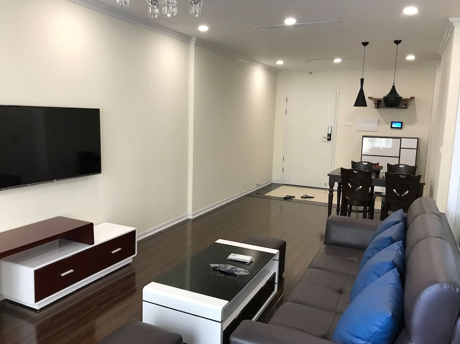4K Television and Leather Sofa