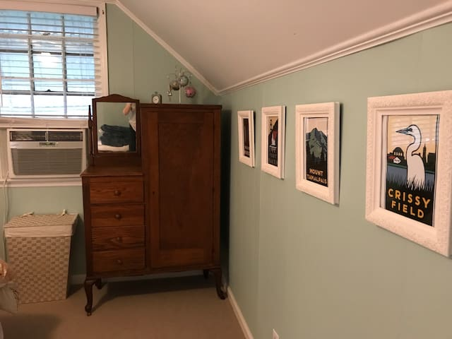 Chifforobe - drawers and hangers. There's more (shared) closet space in the upstairs hall.