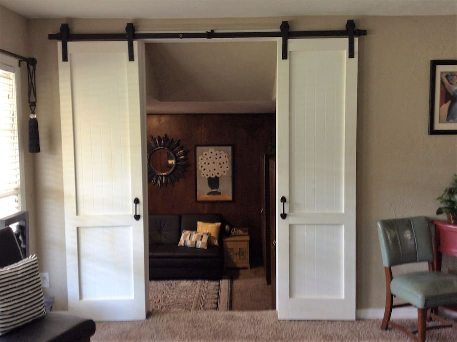 House has sliding barn doors as seen on HGTV.