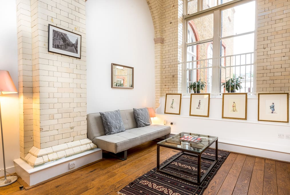 DOUBLE HEIGHT RECEPTION AREA WITH BRICK TILING