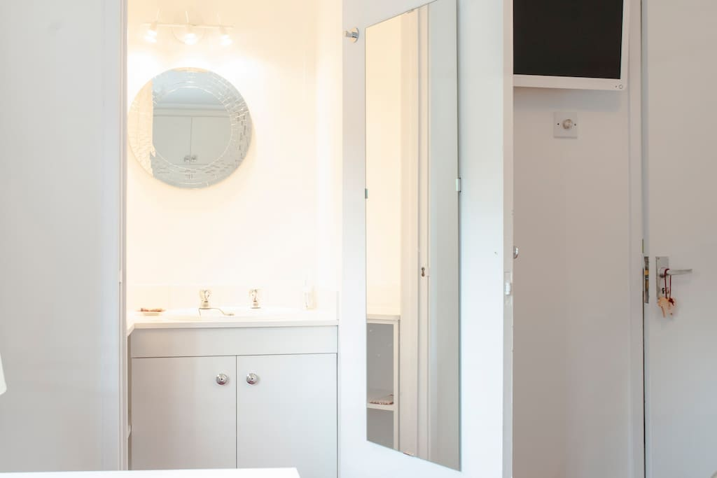 Your en suite wash basin + built in cupboards + full length mirror
