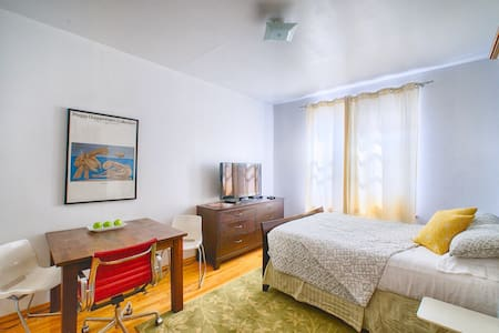 Bright and spacious studio annex with separate entrance and private, in-suite bathroom.  Located on a quiet Greenpoint street, the space includes cable TV, WiFi, Air Conditioning, a bar fridge stocked with bottled water, a Keurig machine with a nice selection of coffee, a hairdryer, an iron with board.