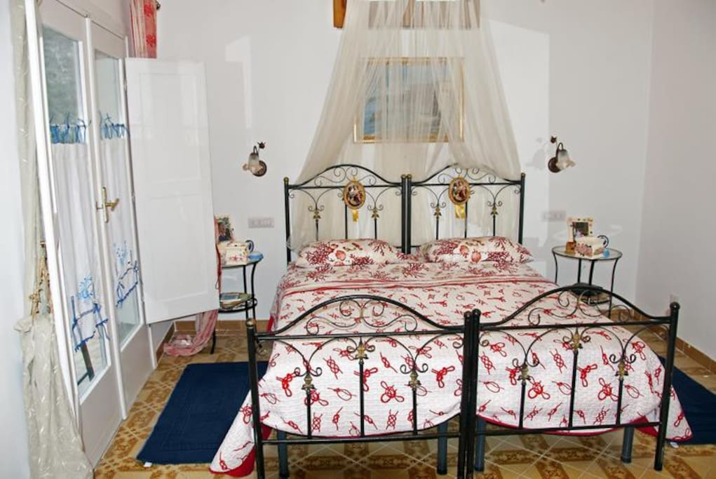 The first bedroom has a matrimonial bed (160 cm/62 inches, wider than a queen-size bed)  In this room you will find a television and air conditioning