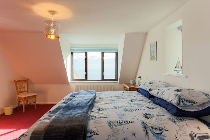 First floor bedroom No. 2 - Large 6 ft double bed or can be split into 2 single beds if preferred. An extra single bed can also be added making it a triple room.  Double aspect with stunning sea views. Sleeps 2-3