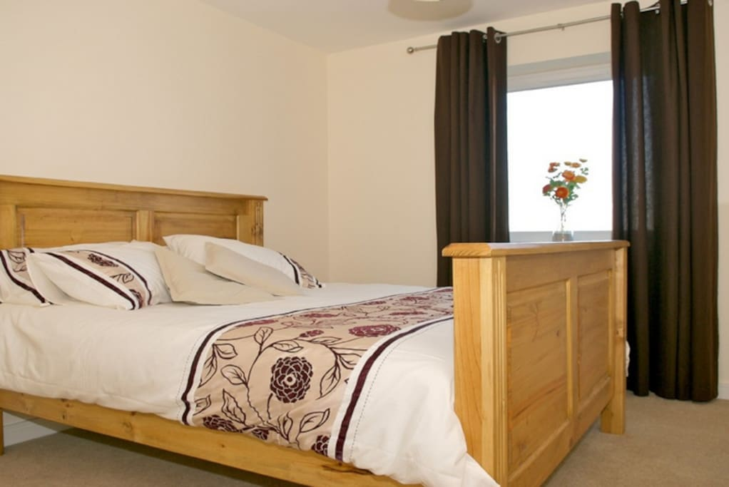 This is the main en-suite Bedroom with King Size bed.