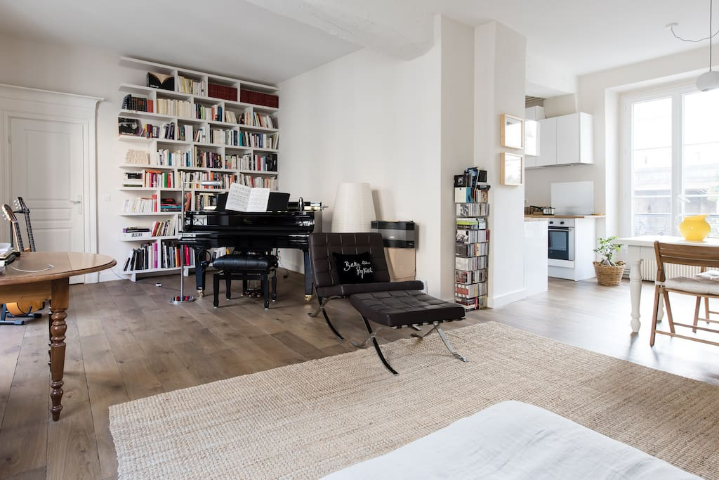 Large living room with grand piano
