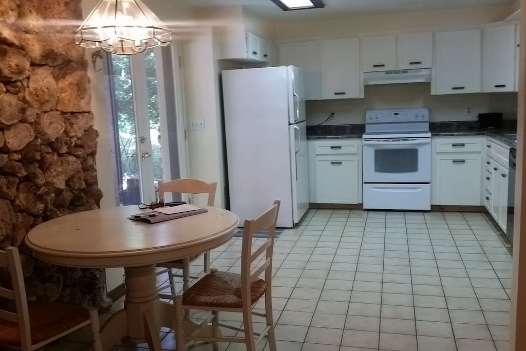 Large, open kitchen with eating area