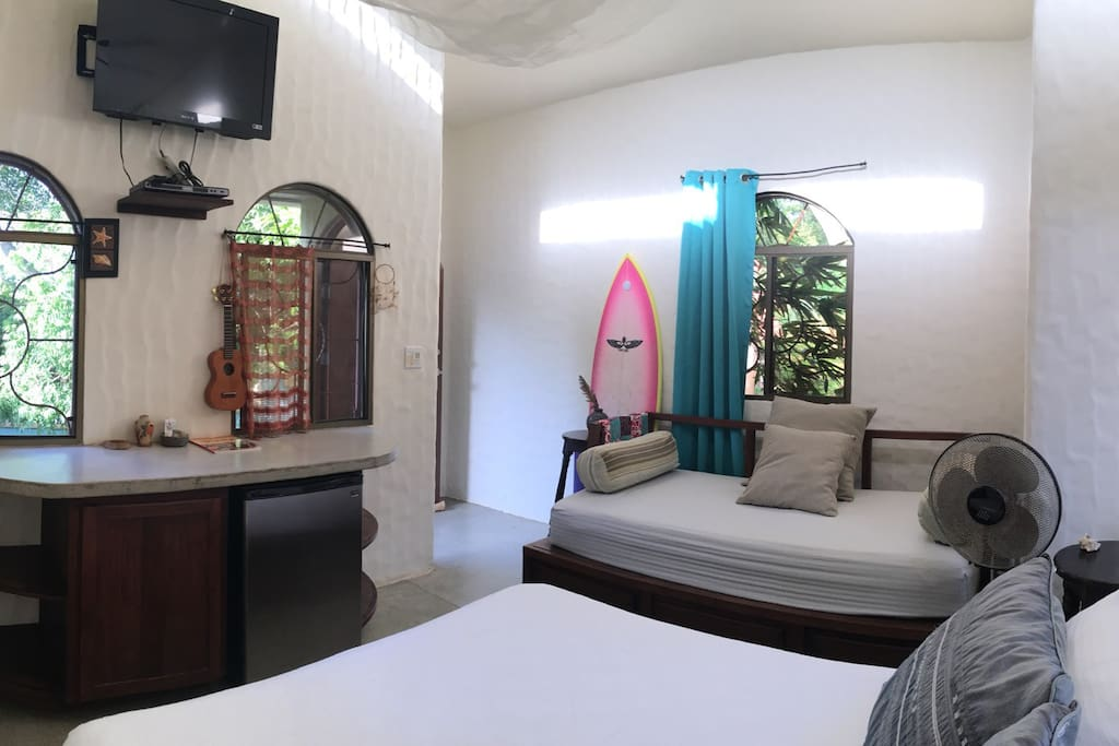 The Guest House, most likely your room. One queen bed, one single bed and a private bathroom with hot water. TV with movies on DVD, fridge for beverages. Sleeps 3. This room is not shared with other travelers but for yourself and your friends.