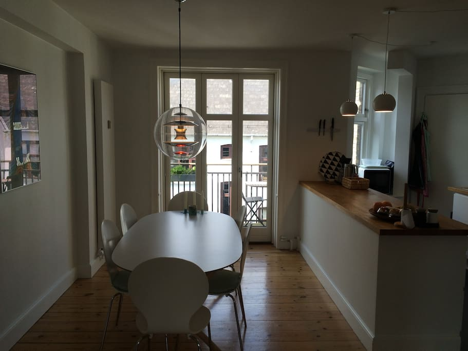 dining area in connection with kitchen and balcony