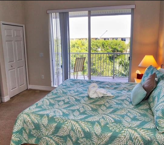 The master boasts a king bed, TV,  en-suite, and WATER VIEW terrace.