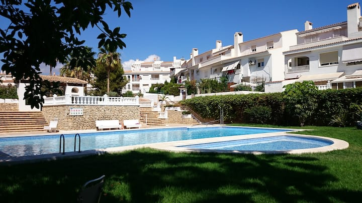 ground floor apartment with terrace, pool, parking