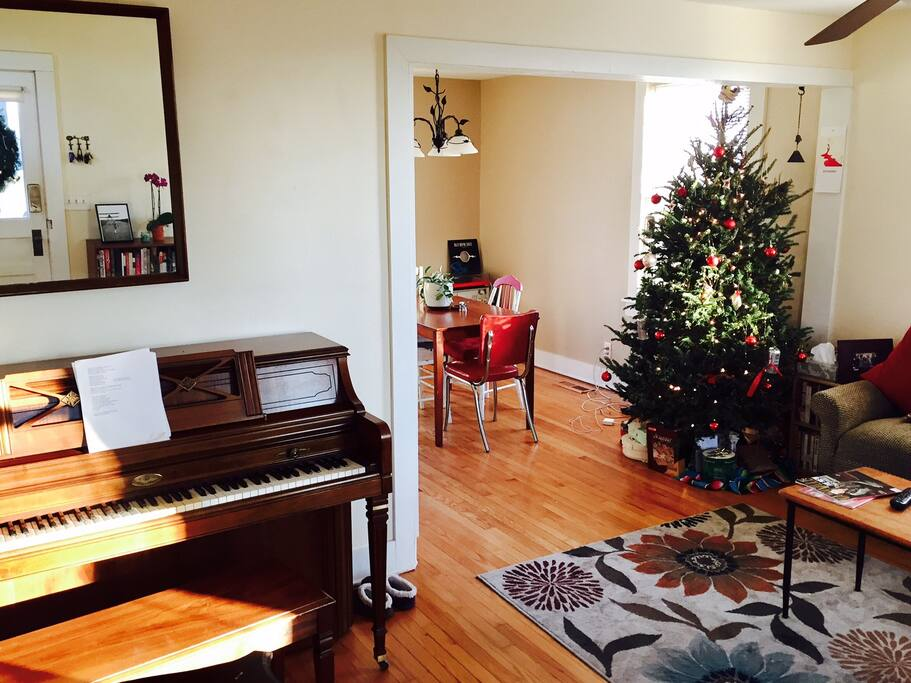 Living Room *feel free to play our Wurlitzer upright piano