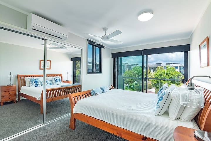 The 2nd bedroom has a king bed and access through the sliders to a juliette balcony with views to the pool area. The bedroom is air-conditioned. The windows have block out blinds for those wishing to sleep in . Both bedrooms have a menu of pillows.
