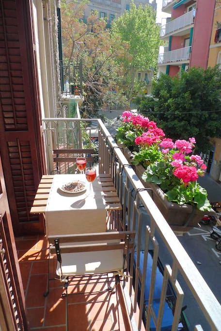 One of the 2 balconies  features a table and 2 chairs for your breakfast or evening drinks