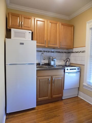 Appliances include a refrigerator, microwave and stove with electric range. Teapot and Keurig machine, too!