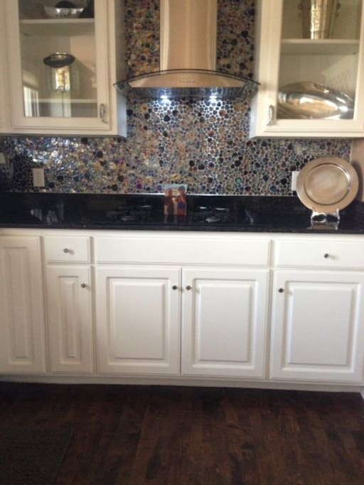 Funky glass tile wall in kitchen.