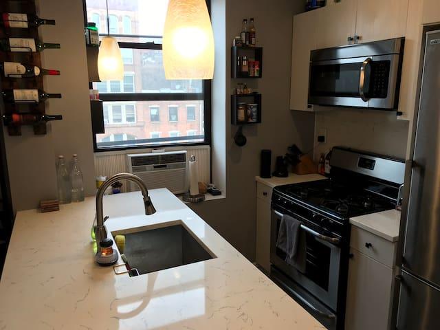 Kitchen - includes refrigerator, freezer, oven, microwave, dishwasher