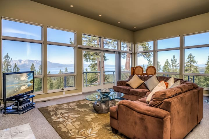 Wall-to-wall windows surround the living area, boasting spectacular vistas.